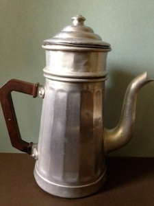 antique coffee pot with a bakelite handle