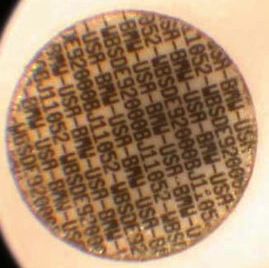 magnified microdot with identifying serial numbers