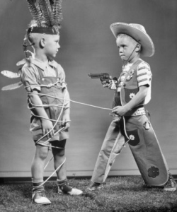 Kids playing 'cowboys and indians'